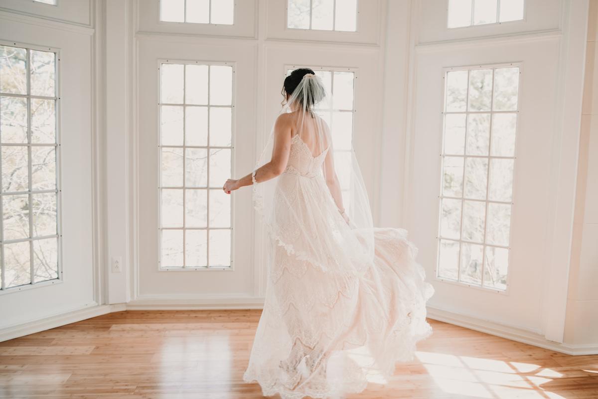 bride in front of windows