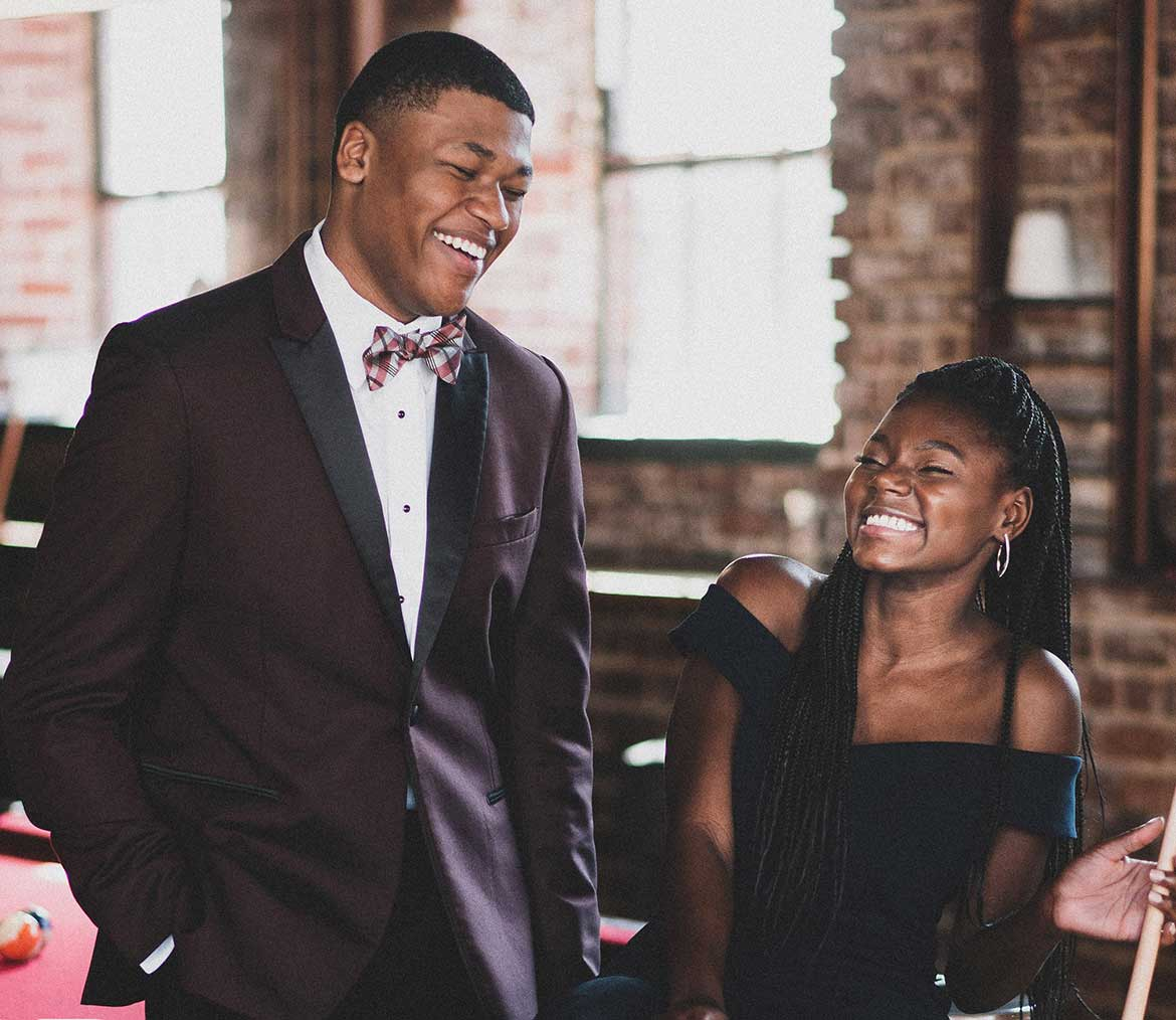 couple laughing in formal wear