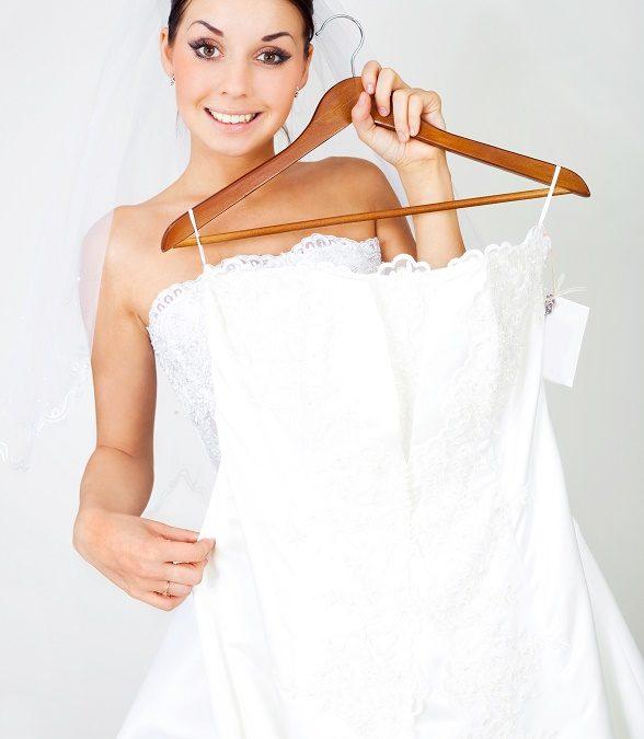 woman holding wedding dress