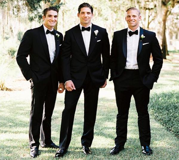 three men in tuxedos
